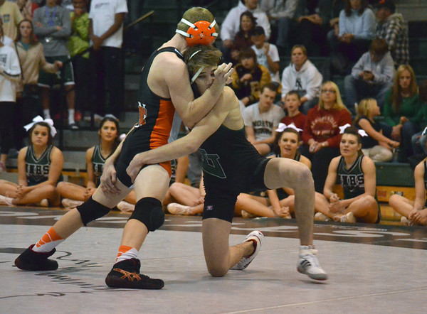 Norman High's Derek Rossgrapples with Norman North's Levi Witten Thursday during the Clash wrestling match at Norman North.<br /> Kyle Phillips/The Transcript