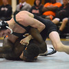 Norman North's Hayden Hanson puts a hold on Norman High's Daniel Mbainayel Thursday during the Clash wrestling match at Norman North.<br /> Kyle Phillips/The Transcript