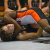 Norman High's Nigel Joliffie pins Norman North's Elijah Tevault to the mat Thursday during the Clash wrestling match at Norman North.<br /> Kyle Phillips/The Transcript
