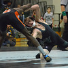 Norman North's Hayden Hanson lunges at Norman High's Daniel Mbainayel Thursday during the Clash wrestling match at Norman North.<br /> Kyle Phillips/The Transcript