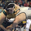 Norman NOrth's Blake Bassham  tries to control Broken Arrow's Tanner Bailey during the 145 lb match in the finals of the OSSAA 6A State Wrestling Tournament Saturday at the State Fair Arena in Oklahoma City.<br /> Kyle Phillips/The Transcript