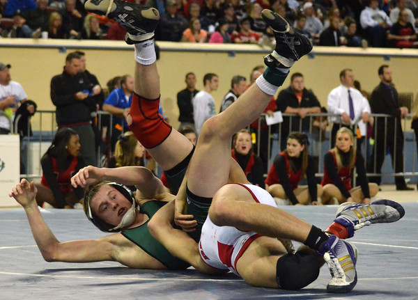 Norman North's Hayden Hanson is slammed to the mat by Tulsa Union'a Luke Wolfenberger  during the 126 lb match in the finals of the OSSAA 6A State Wrestling Tournament Saturday at the State Fair Arena in Oklahoma City.<br /> Kyle Phillips/The Transcript