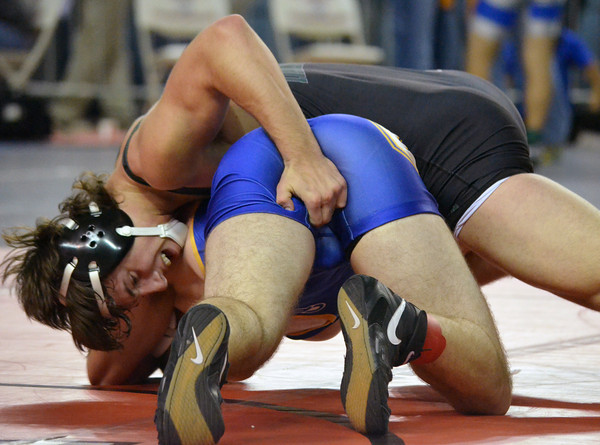 Norman North's Levi Berry tries to flip over Choctaw's Alex Thelin during thier match in the 6A Oklahoma High School Wrestling Championships Friday at the State Fair Arena in Oklahoma City.<br /> Kyle Phillips/The Transcript