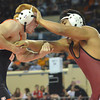 Norman High's Cael Stumpff grapples with Owasso's Teejay Alono during their match in the first round of the Oklahoma High School Wrestling Championships Friday at the State Fair Arena in Oklahoma City.<br /> Kyle Phillips/The Transcript