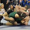 Norman NOrth's Blake Bassham gets tries to break Broken Arrow's Tanner Bailey's hold  during the 145 lb match in the finals of the OSSAA 6A State Wrestling Tournament Saturday at the State Fair Arena in Oklahoma City.<br /> Kyle Phillips/The Transcript