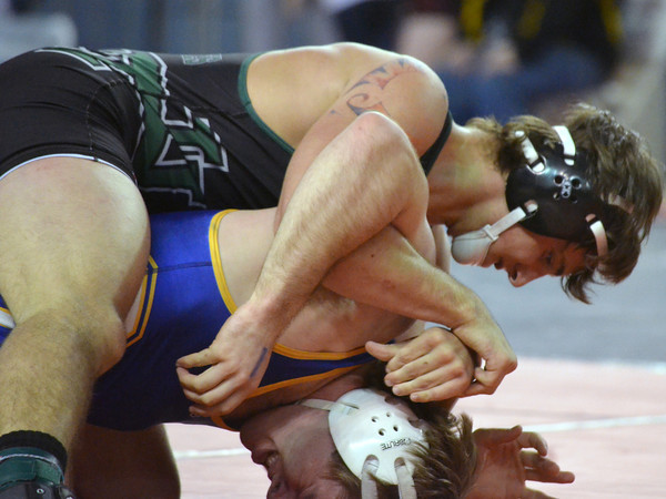 Norman North's Levi Berry pushes Choctaw's Alex Thelin to the mat during thier match at the 6A Oklahoma High School Wrestling Championships Friday at the State Fair Arena in Oklahoma City.<br /> Kyle Phillips/The Transcript