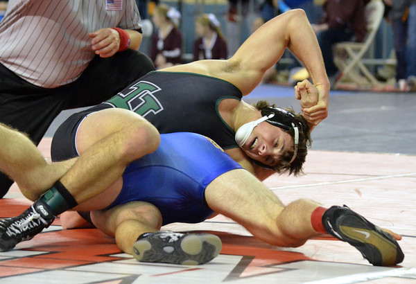 Norman North's Levi Berry wraps up Choctaw's Alex Thelin during their match in the 6A Oklahoma High School Wrestling Championships Friday at the State Fair Arena in Oklahoma City.<br /> Kyle Phillips/The Transcript