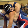 Southmoore's Nathan Marek puts a headlock on Ponca City's Aaron LeClair during their match in the first round of the Oklahoma High School Wrestling Championships Friday at the State Fair Arena in Oklahoma City.<br /> Kyle Phillips/The Transcript