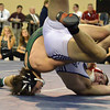 Norman North's Levi Berry slams Ponca's Brannon Hunt Saturdayto the mat during the 160 pound match in the OSSAA 6A State Wrestling Finals at the State Fair Arena in Oklahoma City.<br /> Kyle Phillips/The Transcript