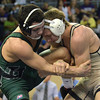 Norman NOrth's Blake Bassham tries to get control of  Broken Arrow's Tanner Bailey's during the 145 lb match in the finals of the OSSAA 6A State Wrestling Tournament Saturday at the State Fair Arena in Oklahoma City.<br /> Kyle Phillips/The Transcript