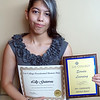 Lilly Gutierrez accepts an award for her participation in the Mendoza Debate society and a plaque for completing 30-49 hours of service learning at the recent 2016 Lee College Presidential Honors Day Ceremony.