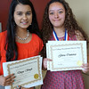 Divya Singh (left), a sophomore at IMPACT ECHS, displays her certificate for excellence in government,  and Gloria Contreras, an IMPACT ECHS junior, receives recognition for excellence in the course The Human Condition and as an Honors Program completer.