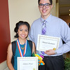 Adriana Rezal (left) receives an award for excellence in biology and recognition as an Honors Program completer, and Siavash Zamirpour receives recognition for excellence in chemistry and for his exceptional work in the Honors Program.