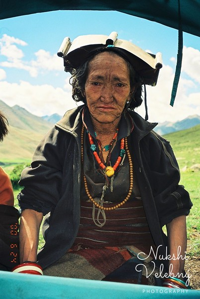 Old woman from the pasture with silver head gear