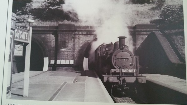 A photo of a photo showing a loco near Highgate station.