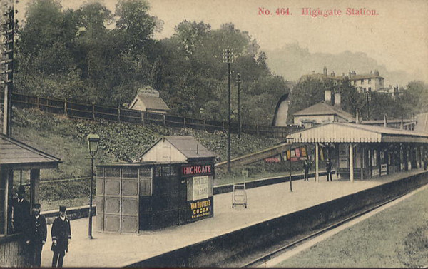 Superb old post card showing staff on the platform