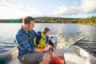 Father and son boating.