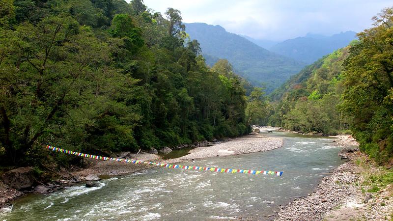 Prayer flags over the Mo Chhu river, Jigme Dorji N.P. Photo by guide Richard Webster.