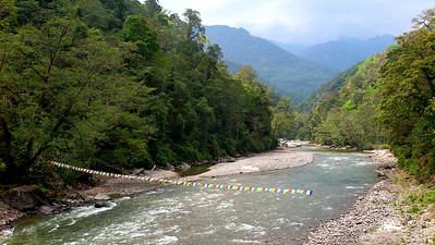 Prayer flags over the Mo Chhu river, Jigme Dorji N.P. Photo by guide Richard Webster.