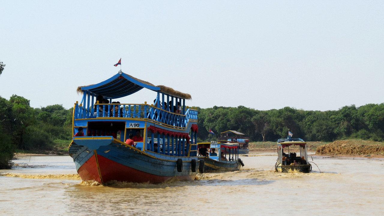 Tourists boats leaving the floating village of Prek Toal. Photo by guide Phil Gregory.