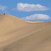 A 2017 participant is dwarfed by the Khongor Dunes, by guide Phil Gregory.