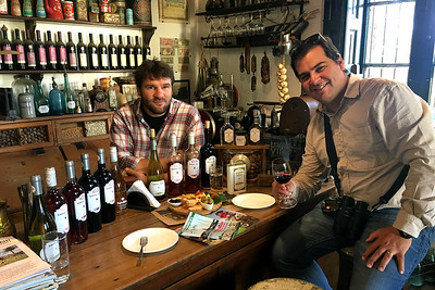 Choosing the best wine at Almacen de la Capilla, by guide Marcelo Padua.