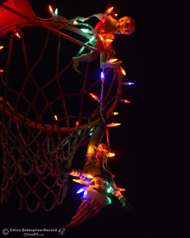 . A couple of elves getting tangled in the Christmas lights at Tina Beers house on 115 Grand Avenue a must see on this year\'s Oroville Tour of Lights Thursday December 7, 2017 in Oroville, California. (Emily Bertolino -- Mercury Register)