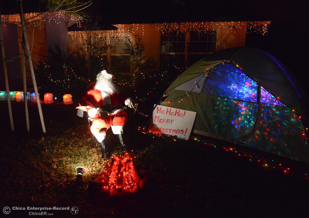 . Santa Claus goes camping, relaxing by the fire and roasting marshmallows; a unique Christmas light display on this year\'s Chico Tour of Lights December 5, 2017 along Silver Lake Drive in Chico, California. (Emily Bertolino -- Enterprise-Record)