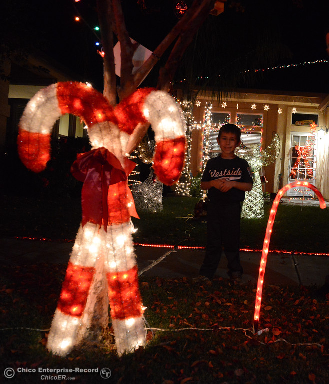 . Harper Honea, 6, stands in a candy caneforest in front of his house filled with homemade Christmas lights a must see on this years Chico Tour of Lights December 5, 2017 along Elisha Court in Chico, California. (Emily Bertolino -- Enterprise-Record)