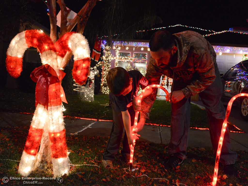 . Marc and Harper Honea, 6, set up Christmas lights for this year\'s Chico Tour of Lights December 5, 2017 along Elisha Court in Chico, California. (Emily Bertolino -- Enterprise-Record)