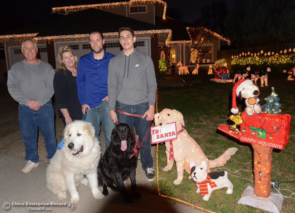 . The Gray family, Ian, Kelly, Russ and Chris stand with their dogs Buddy and Buster in front of their home adorned with dog Christmas lights Wednesday December 6, 2017 in Chico, California. (Emily Bertolino -- Enterprise-Record)