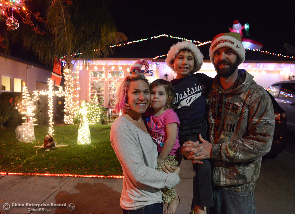 . The Honea family, Mindy, Jersey, 3, Marc and Harper, 6, stand in front of their homemade Christmas light display, a must see on this year\'s tour of lights Chico Tour of Lights December 5, 2017 along Elisha Court in Chico, California. (Emily Bertolino -- Enterprise-Record)