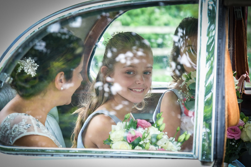 Bridesmaid is excited as she looks forward to the ceremony