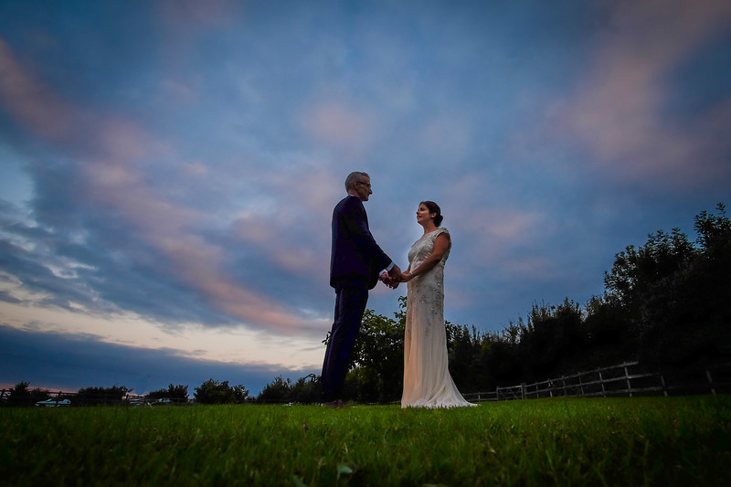 A swirling red sky predicts a fine future. Jo and Andys wedding at Wick Farm, nr Bradford-on-Avon.