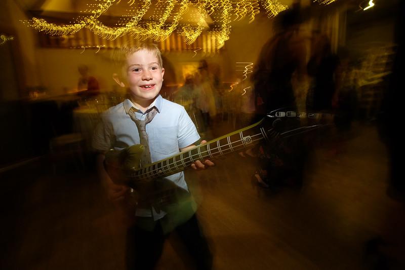 boy playing the air guitar at wedding