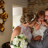 right after the eremnony bride and groom spend a special moment with their bridesmaid. this image brought back lots of warm feelings about the day for bride and groom when we looked through the wedding photographs together after the wedding
