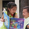 """Leah reads """"Inside Out"""" to Matthew"""