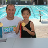Alice holding a gold medal with Olympic gold medalist Jason Lezak