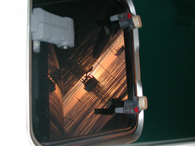 Kuto Bay, western horizon reflection in master cabin escape hatch