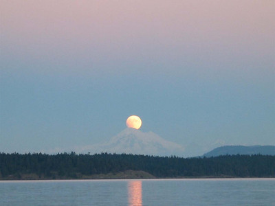 Lunar eclipse: moon over Mount Baker, from Friday Harbor aboard ADAGIO.
