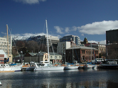 Aug, 2001: Hobart, Tasmania: Adagio at Constitution Dock,  with snow on Mt. Wellington. Our first winter in Tassie.