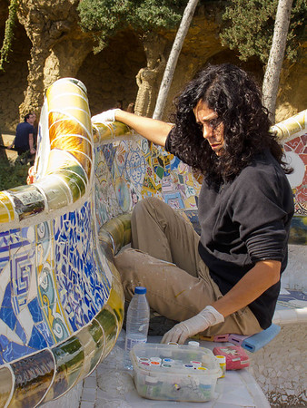 Artists were repairing and touching up the mosaics on the serpentine seating.