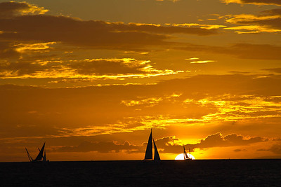 From our anchorage in Baie de l'Orphelinat, we had front row seats for the sunset races .