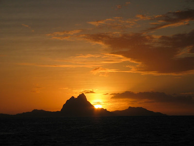 Sun setting over Bora Bora, view from ADAGIO's anchorage in Baie de Pueheru, Taha'a, French Polynesia
