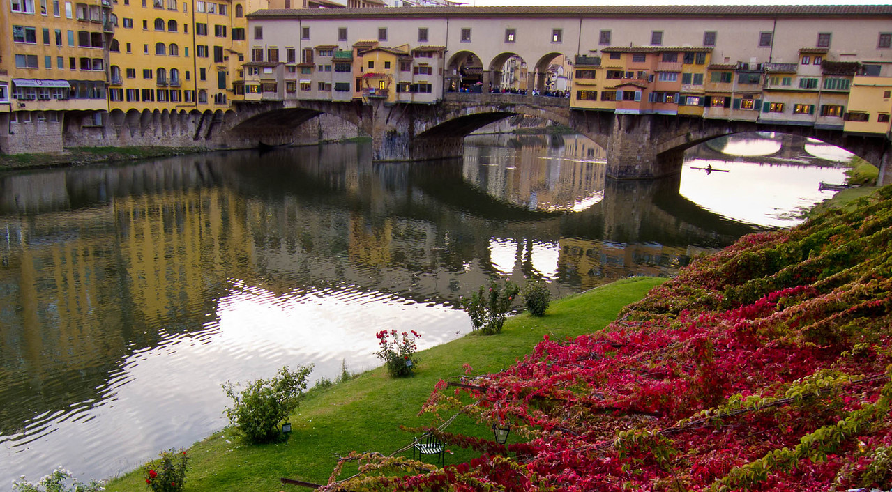 Ponte Vecchio and the riverside cafe lawn.