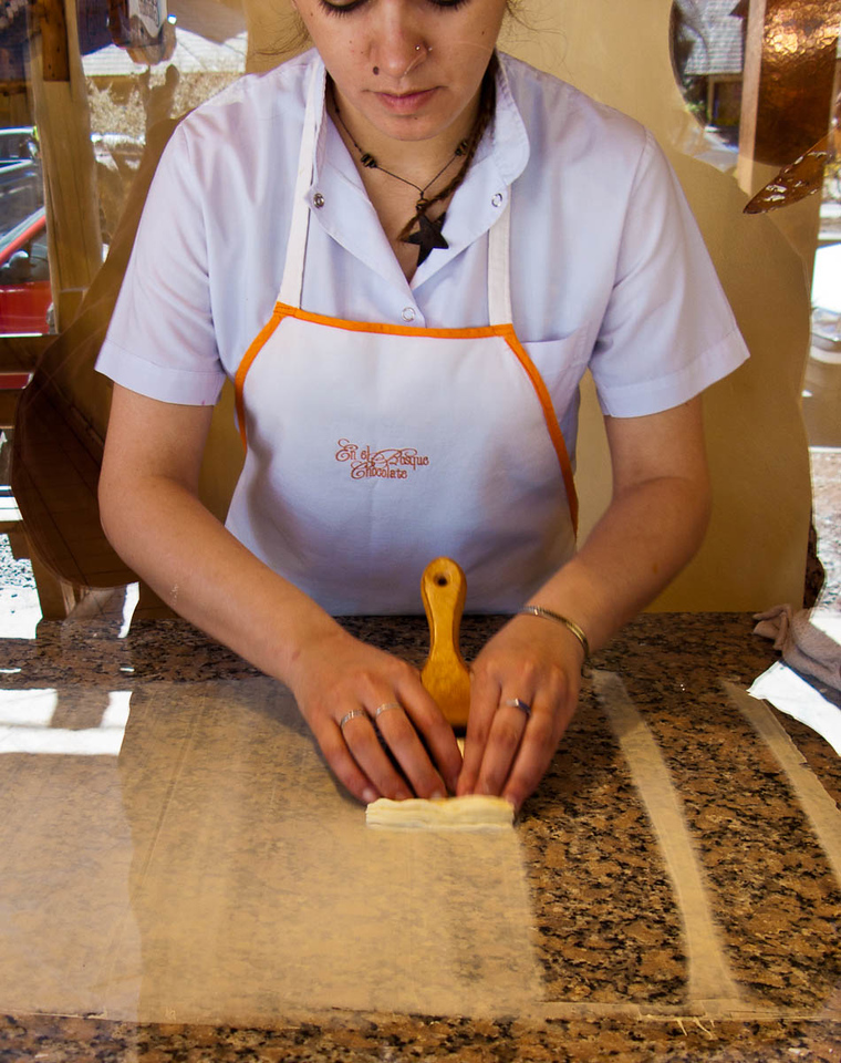 """In Villa la Angostura, the chocolate shops were making """"logs"""" of chocolate by spreading chocolate on a granite slab and accordian pleating it while still pliable."""