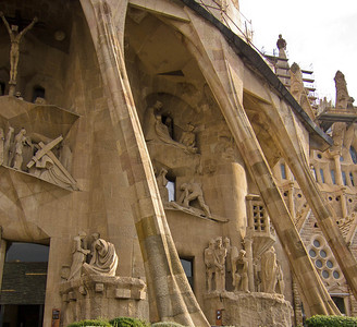 The Passion facade shows the stone work designed by Josep Maria Subirachs, and Gaudi's supporting architecture.