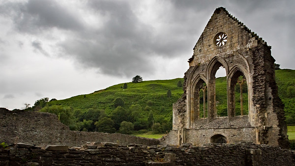 Remains of the Valle Crucis Abbey church's west end on a soggy day