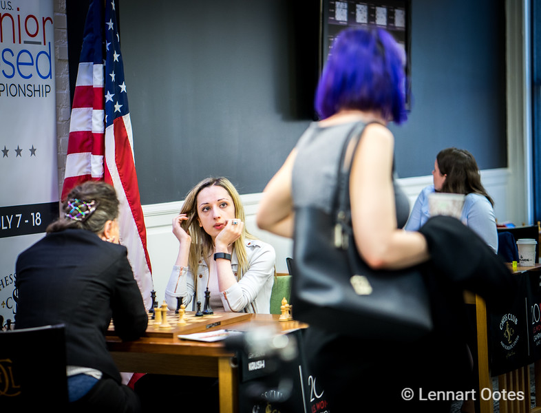 Nazi Paikidze looks up to tournament leader Tatev Abrahamyan, who just lost her game in the final round of the US Chess Championships. Pakitze realizes that a win vs top seed Irina Krush would bring her the title. She won the game convincingly.