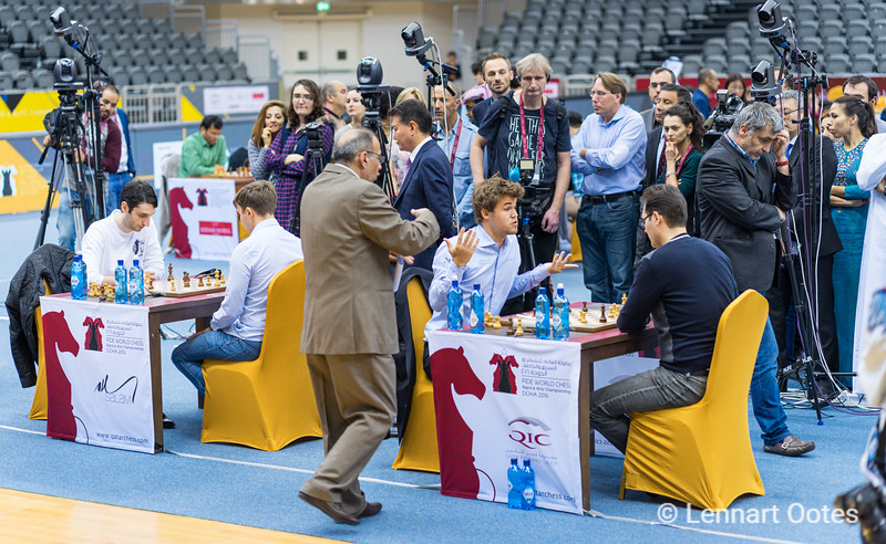 Magnus Carlsen had to settle with a draw in the final rund of the World Rapid and Blitz 2016 in Doha. It gave Sergey Karjakin the chance to win the gold medal after beating Baadur Jobava. WHile most of the spectators are focussed on the games, you will see Ivanchuk walking around in his own thought.